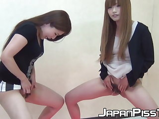 Shy Japanese broads show off hairy love hole while pissing
