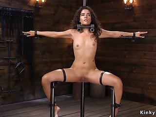 Brunette in device bondage fucked rough