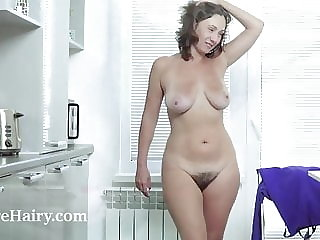 Gadget has orgasms as she orgasms in her kitchen