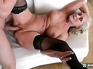 GILF in stockings gives client a three way service
