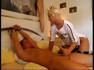 Broad in sex latex boots strokes his fuck pole