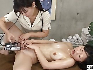Japanese lesbian massage – naked client gets fingering treatment