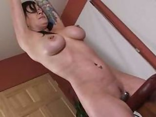 Submissive woman rides a vibrator while being spanked