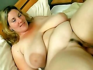 She pleases him with huge tits and fat pussy