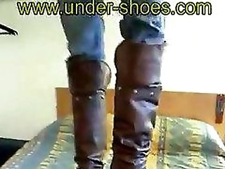 Brown boots trampling
