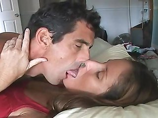 Couple erotic deep sensuous tongue kissing in bed.