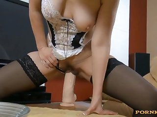 This amateur kinky house maid teasing in sexy lingerie and riding on top of a stiff dildo