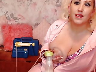 Busty British blonde shows how to pump breast milk