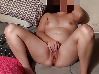 Wife playing her meaty pussy